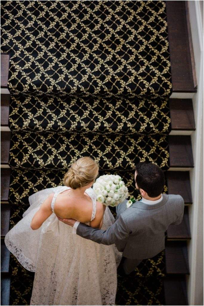 Bride and groom walking up the stairs at the St. Louis Women's Club