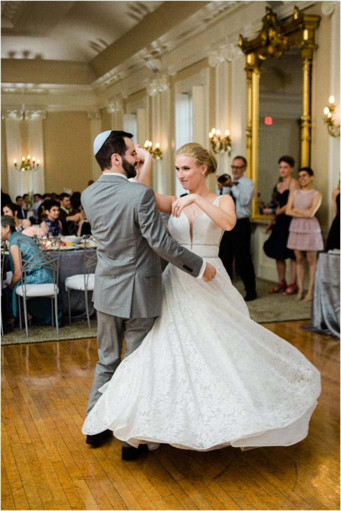 Groom spins the bride during the fist dance at the St. Louis Women's Club