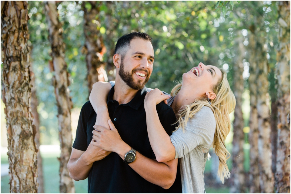Laughing, candid engagement Session Forest Park