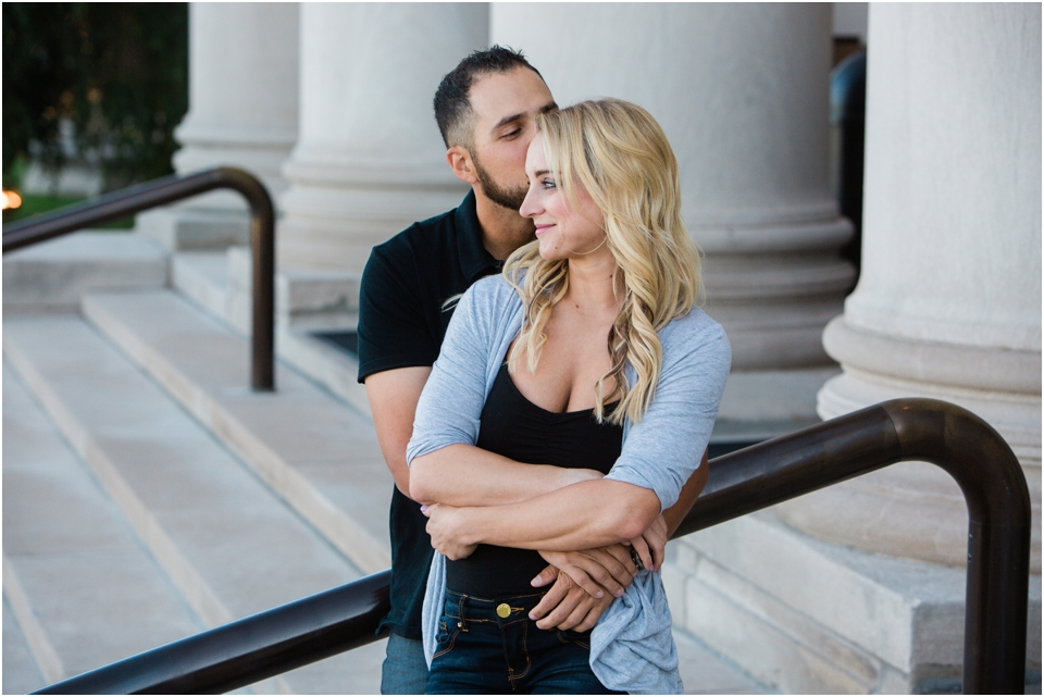 man holding his fiancé on the steps of the St. Louis Art Museum