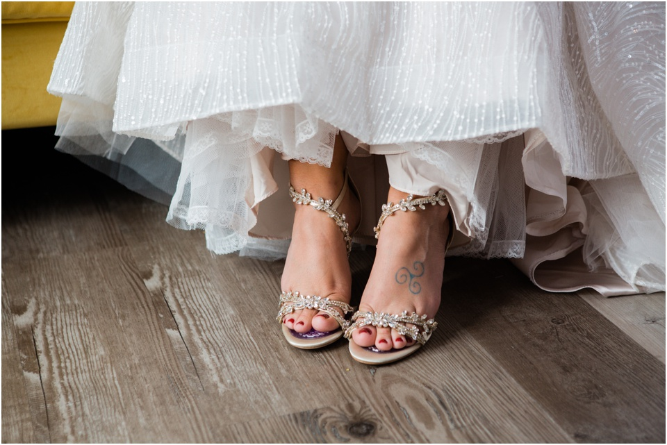 Bride's wedding shoes with leaf embellishments