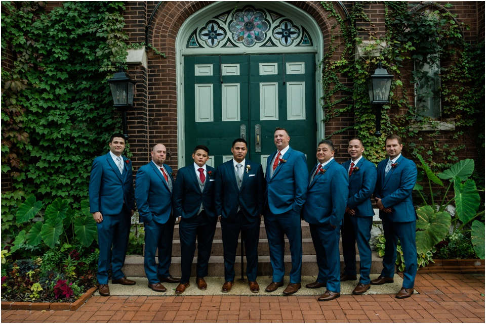 Groom and groomsmen in front of 9th Street Abbey
