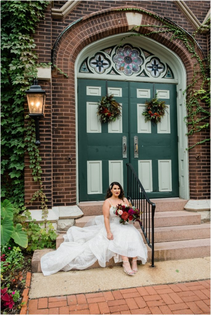 Bride sitting on the steps of the 9th Street Abbey in soulard