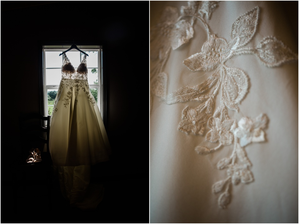 Ivory lace wedding dress hanging in the window of farm house
