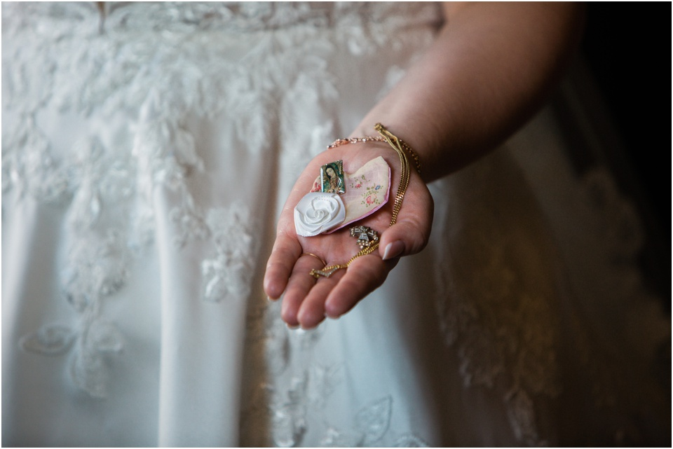 Bride holds treasures from her grandparents that she will carry down the aisle