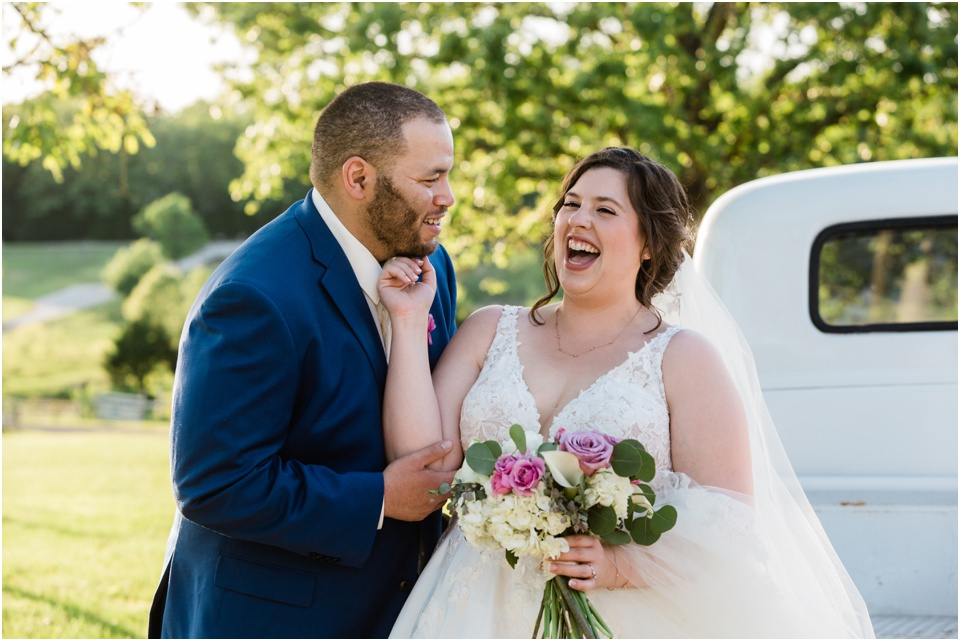 Candid laughter between bride and groom