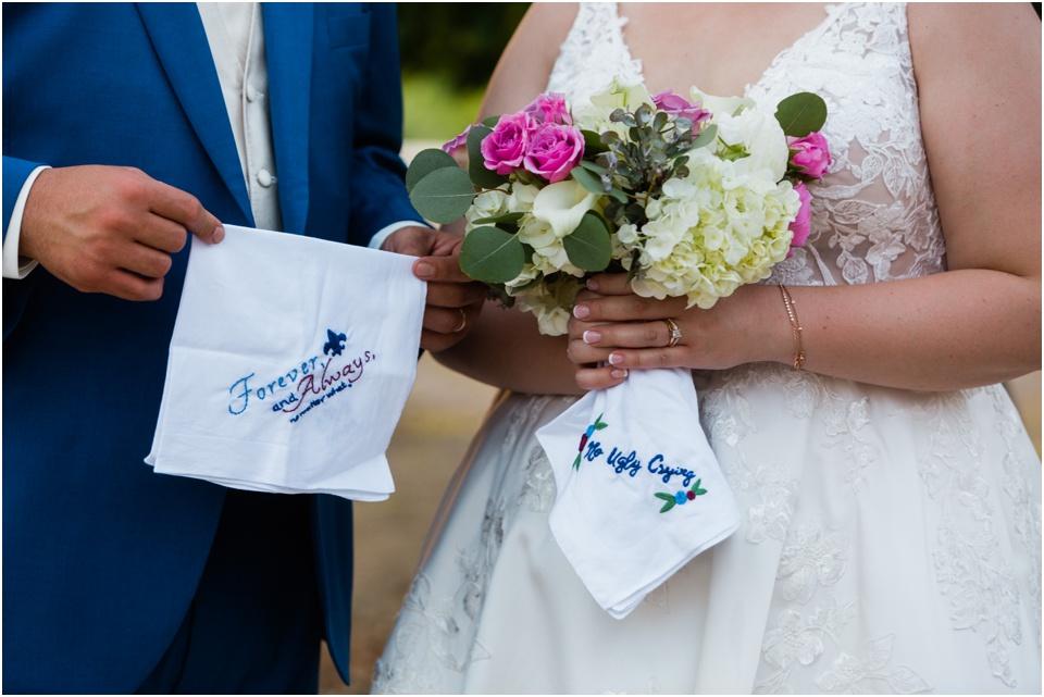 Bride and groom sporting their custom embroidered wedding handkerchiefs