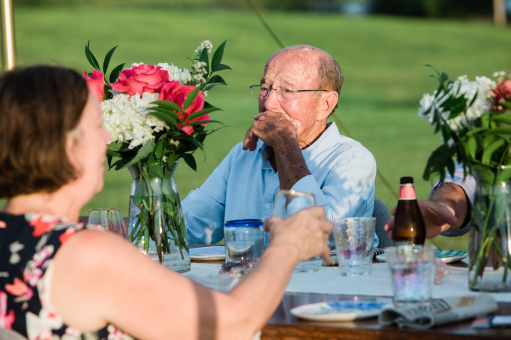 Grandfather gets teared up as he gives toast to the newlyweds.