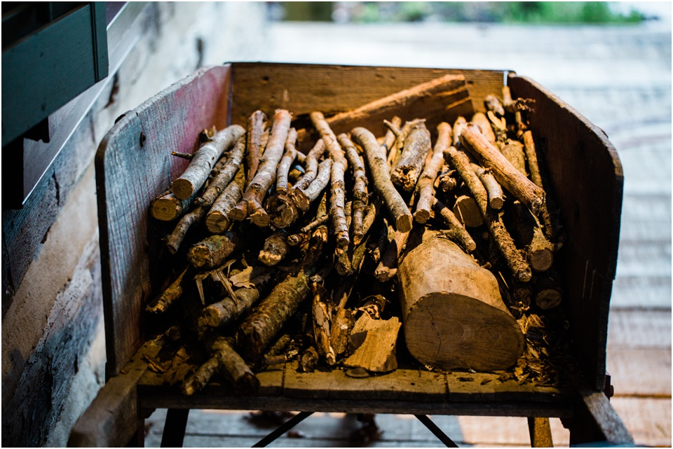 firewood sticks lay by the back door in an old, wooden wheelbarrow