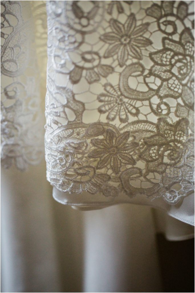 Close up of antique white lace on wedding dress