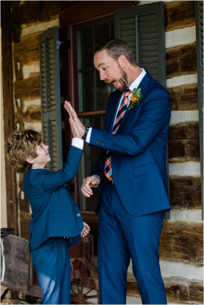 Groom and new step son give each other a high five